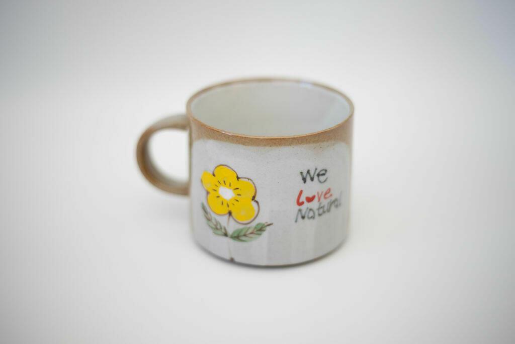 We Love Natural Mug-yellow flower   Trada Marketplace